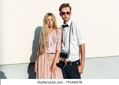 Beautiful hipster young couple in love summer street portraits in the city