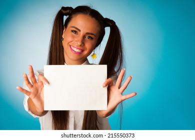 beautiful hispanic business woman holding blank card over blue background