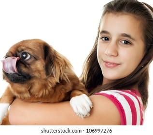 Beautiful hispanic girl carrying her pet pekingese dog isolated on white