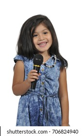 Beautiful hispanic girl singer performing at a concert