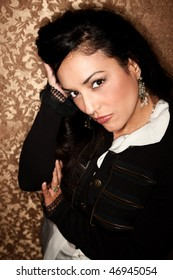 Beautiful Hispanic Woman with Dark Hair on Gold Background