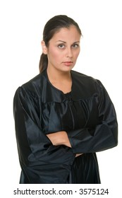 Beautiful Hispanic woman judge in black judicial robes standing with her arms crossed.