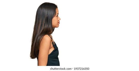 Beautiful hispanic woman wearing casual clothes looking to side, relax profile pose with natural face with confident smile.