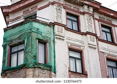 Beautiful historic building in need of restoration. Art nouveau (Jugendstil) architecture sample. Riga, Latvia, Europe.