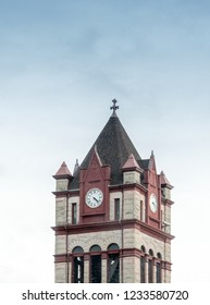A beautiful, historic clock tower rises over a small town in Michigan USA