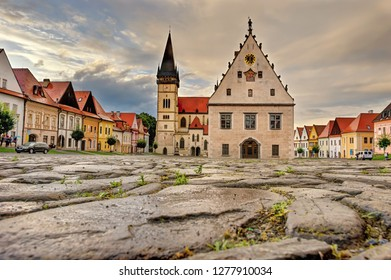 Beautiful historic town square with old building of church and colorful houses in the city Bardejov in Eastern Slovakia in Europe, which is listed in UNESCO world heritage