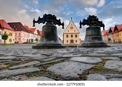 Beautiful historic town square with pair of big iron bells and surrounding old buildings and colorful houses in city Bardejov in Eastern Slovakia in Europe, which is listed in UNESCO world heritage
