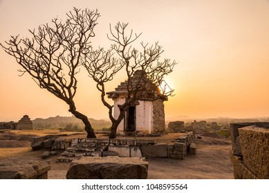 Beautiful historical ruins from 14th century Vijayanagara empire in Hampi at sunset from Hemakuta hill.