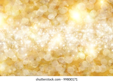 the beautiful holiday abstract  background of gold circle with sparklets