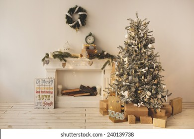 Beautiful holiday decorated room with Christmas tree with present boxes under it