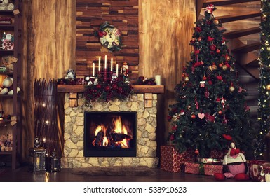 Beautiful holiday decorated room with Christmas tree, fireplace at night. Led lighting, cozy home scene. Nobody there.