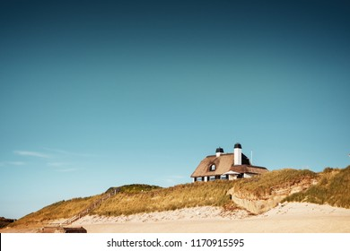 Beautiful holiday house on the beach sand dunes with sea view and blue sky. Perfect home for summer sacndinavian holidays  Løkken, Lønstrup in North Jutland in Denmark, Skagerrak, North Sea