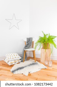Beautiful home decor with cozy textiles and green plant, inspired by Scandinavian design.