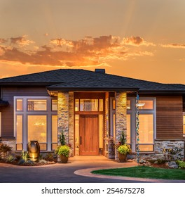 Beautiful Home Exterior at Sunset/Sunrise with Glowing Orange Sky