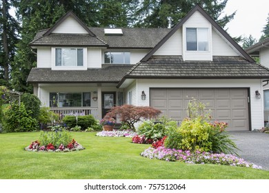 Beautiful Home and Flower Garden in Full Bloom.