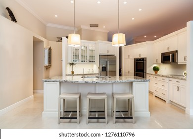Beautiful home kitchen with white cabinets.