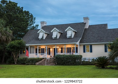 Beautiful home lit up at twilight.