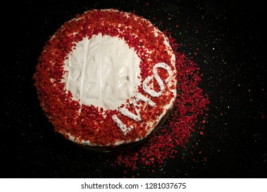 Beautiful home made red velvet cake decorated with whipped cream and raspberry crumbs. Celebrating 100th anniversary of Latvia or 100th birthday.