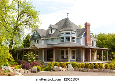 A beautiful home in Oregon has a well manicured landscaped yard and great architecture.