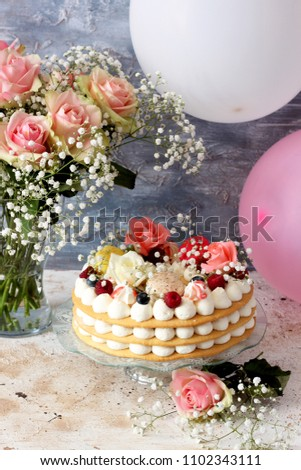 Beautiful Homemade Cake Decorated With Flowers And Berries
