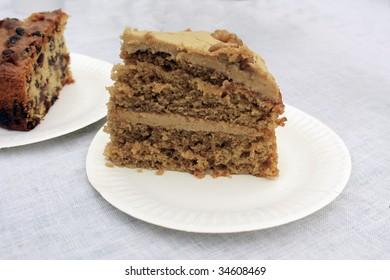 a beautiful home-made coffee and walnut cake on a white plate