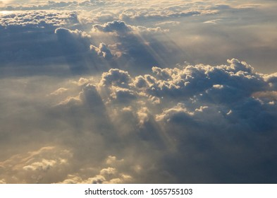 Beautiful horizon during sunset above cloud, with sunbeams (god rays) above cloud