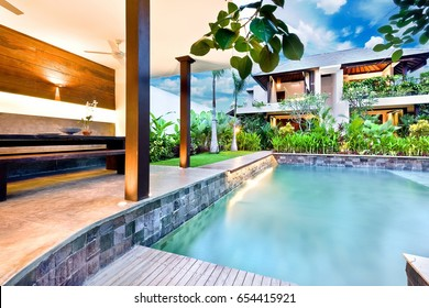 Beautiful hotel or house in the morning, including a swimming pool beside the garden next to house