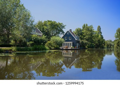Beautiful house along river Graafstroom on en sunny day