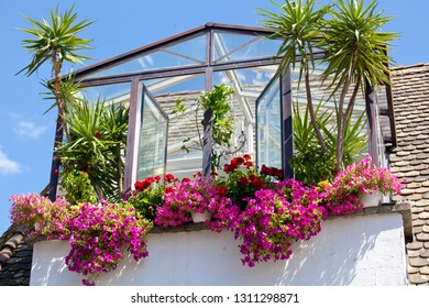 beautiful house balcony window decorated with lots of flowers and tropical plants, postcard with empty tourism background