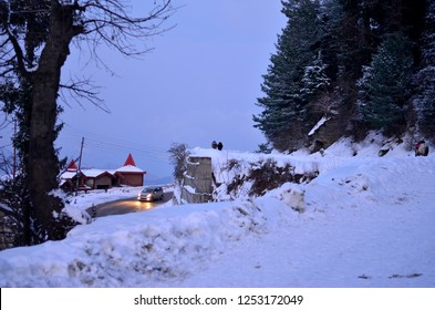 Beautiful house covered under snow and a snow laden road after recent snowfall in Kufri, Shimla, Himachal Pradesh, India. It is a popular winter tourist destination for enjoying snowfall and skiing.