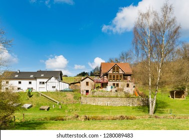 A beautiful house in the Eifel hills in Daun, Germany in spring.