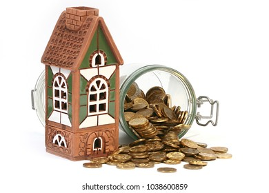 a beautiful house and metal rubles in a glass pot like an accumulation