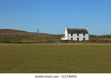 Beautiful house on a grassy meadow in Scotland