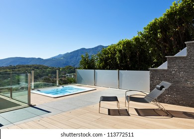 beautiful house outside, modern style, deckchair  and jacuzzi