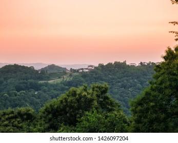 Beautiful houses on green hill at sunset, Italy, Friuli Venezia Giulia
