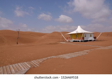 Beautiful houses in the resort in the desolate and barren desert. Wooden planks can walk to the bungalows.