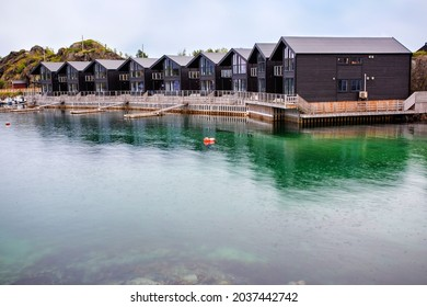 Beautiful houses in a row in a little village called Hamn i Senja on Senja island, Norway