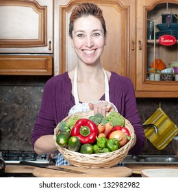 beautiful housewife with basket of vegetables in the kitchen