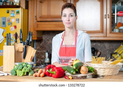 beautiful housewife cooking vegetables in the kitchen