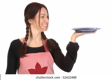beautiful housewife holding empty plate on white background