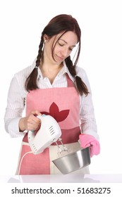 beautiful housewife preparing with kitchen mixer on white  background