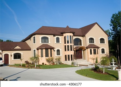 Beautiful, huge mansion in a very upscale neighborhood. Driveway encircles front of property. Real Estate Investment.