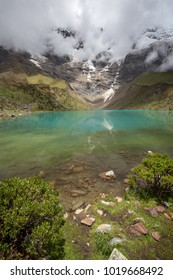 Beautiful Humantay lake and glacier at the summit of Salkantay mountain outside of Cusco, Peru in the Peruvian countryside.