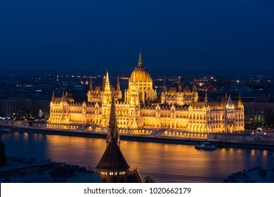 The beautiful hungarian Parliament by night, reflected on the Danube, Hungary