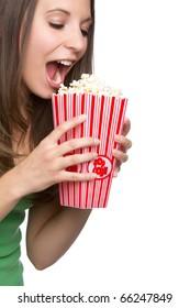 Beautiful hungry girl eating popcorn