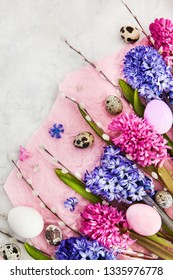 Beautiful hyacinths, willow and  Easter eggs on light background, top view, spring holiday concept