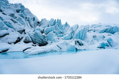 Beautiful ice formations and caves of Matanuska glacier in the winter surrounded by snow. Near Anchorage, in Alaska.
