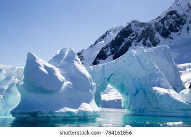 A beautiful Iceberg glowing blue in Pleneau Bay, Port Charcot, Antarctica
