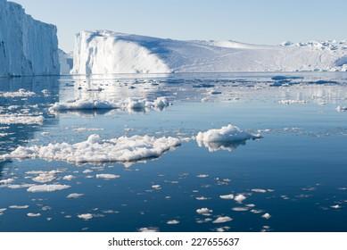 Beautiful Icebergs in Disko Bay Greenland around Ilulissat with blue sky