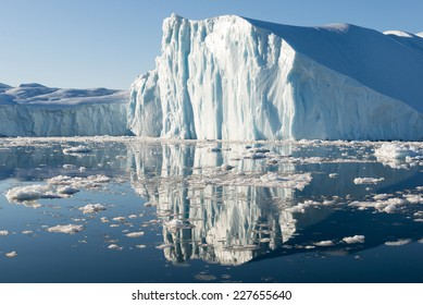 Beautiful Icebergs in Disko Bay Greenland around Ilulissat with blue sky
